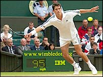 Tim Henman in action against Sebastien Grosjean