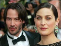 Keanu Reeves and Carrie-Anne Moss at Matrix premiere, AP