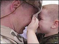 Soldier bids farewell to baby