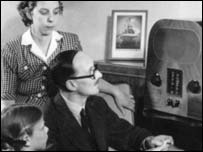 Family gathers around a radio, BBC