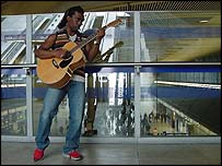 Busker Hanger Lane at Canary Wharf station