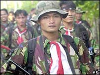 Indonesian special force soldiers patrol at Samalanga in Aceh province