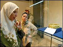Iraqi women gaze at the new exhibition of Iraqi treasures in the National Museum in Baghdad, on 3 July 2003