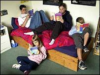 Children reading Harry Potter books