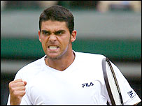 Mark Philippoussis in action against Alexander Popp