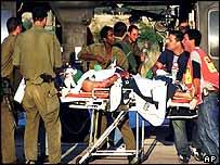 Israeli medics evacuate an Israeli man