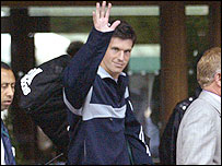 Tim Henman waves goodbye as he leaves the All England Club