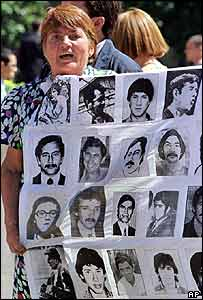"A woman holds pictures of the ""disappeared"""