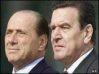 Silvio Berlusconi (left) and Gerhard Schroeder