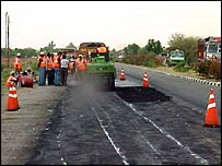 Repair work on the highway in preparation for the monsoon season