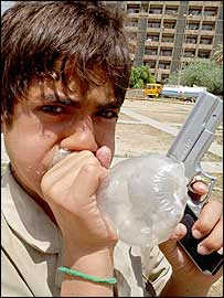 Orphan Ahmed Abdullah Sallal sniffs thinner fumes from a plastic bag