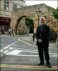 City Archaeologist Michael Jones by the Newport Arch