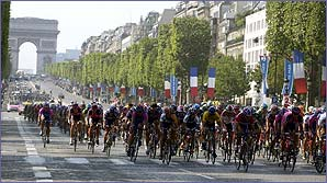 Riders do laps of the Champs Elysees in Paris in the 2002 Tour de France