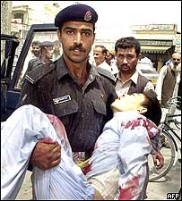 Policeman with injured worshipper