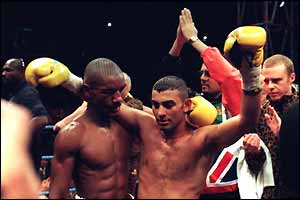 Hamed celebrates winning his first world title in Cardiff in 1995