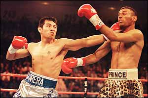 Marco Antonio Barrera dishes out some punishment to Naseem Hamed in 2001