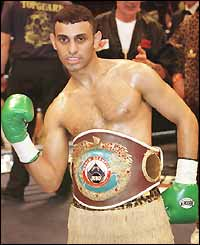 Naseem poses with his WBO featherweight belt after beating Said Lawal