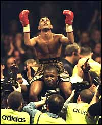 Naseem Hamed celebrates his win over Tom Johnson in 1997