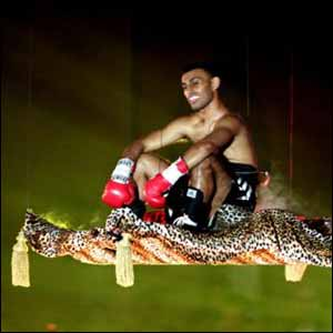 Hamed arrives in the ring via a flying carpet