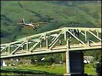Pilot goes under bridge