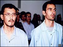 Japanese photographer Hiroki Gomi, left, and his translator Abdel Salam Helwa in court