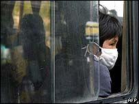 Passenger wears a protective mask on a long-distance bus, Shanghai