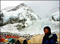 A mountaineering team waits for better weather to reach the summit