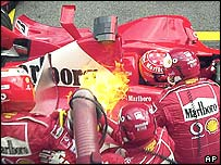 Michael Schumacher sat coolly in his car while the fire burned in Austria
