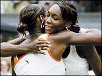 Venus and Serena Williams embrace after the end of the match