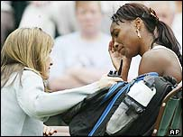 A tour trainer talks to a suffering Venus Williams