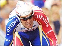 David Millar races across the finishing line for the prologue