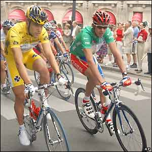 Brad McGee and David Millar lead the riders during a parade through Paris