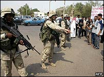 US soldiers keep back demonstrators in Baghdad