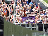 Orangemen protesting at the barrier which prevents them going down the Garvaghy Road