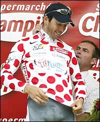 Christophe Mengin of Francaise des Jeux pulls on the polka dot jersey for best climber