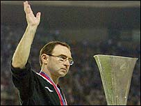 Martin O'Neill salutes the Celtic fans after the Uefa Cup defeat