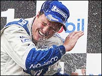 Ralf Schumacher is sprayed with champagne after winning the French Grand Prix