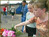 Flowers are laid at the site of Saturday's suicide attacks in Moscow