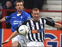 Rangers' Neil McCann challenges Lee Bullen of Dunfermline