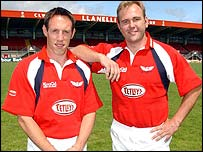 Mark Taylor and Scott Quinnell model the new Llanelli Scarlets kit