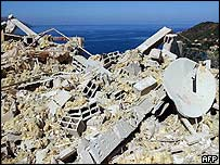 Rubble from destroyed holiday villa