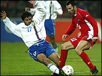 Ryan Giggs is tackled by an Azerbaijan defender