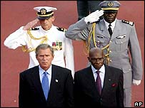 US President George Bush (left) stands next to Senegalese President Abdoulaye Wade as they listen to national anthems upon Bush's arrival at the presidential palace in Dakar 8 July 2003