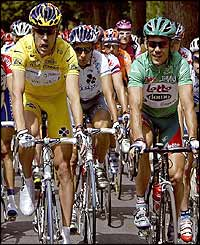 Australian Bradley McGee sports the leader's yellow jersey alongside compatriot Robbie McEwen