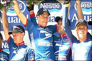 Lance Armstrong leads the US Postal celebrations on the podium