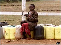 Child guards water containers in Kenya