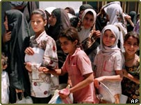 Children queuing for food in Baghdad