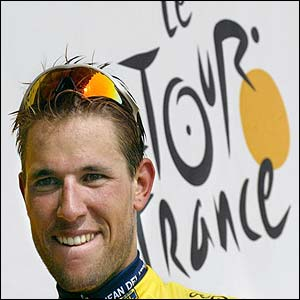 Frenchman Jean-Patrick Nazon celebrates on the podium after claiming the yellow jersey after the third stage