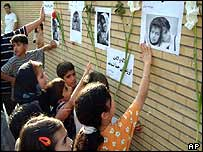 Iranian children pay tribute to the sisters