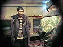 Chechen being interrogated in filtration camp